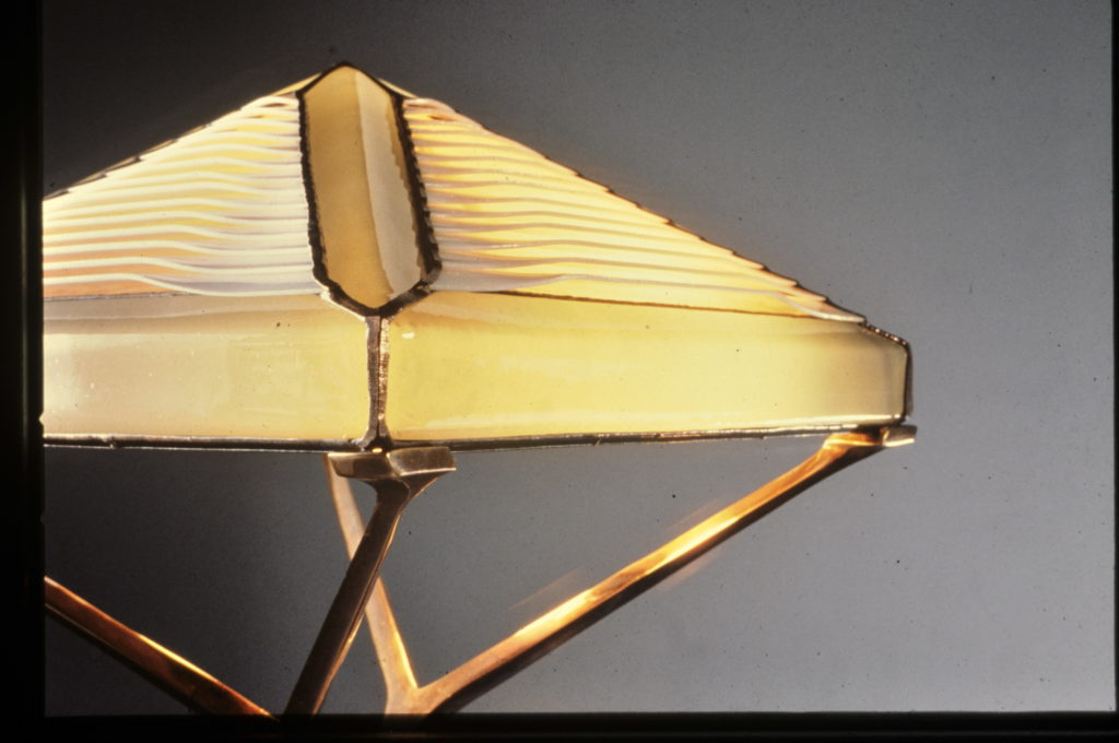 Close up of Pyramid floor lamp (bone colored glass)